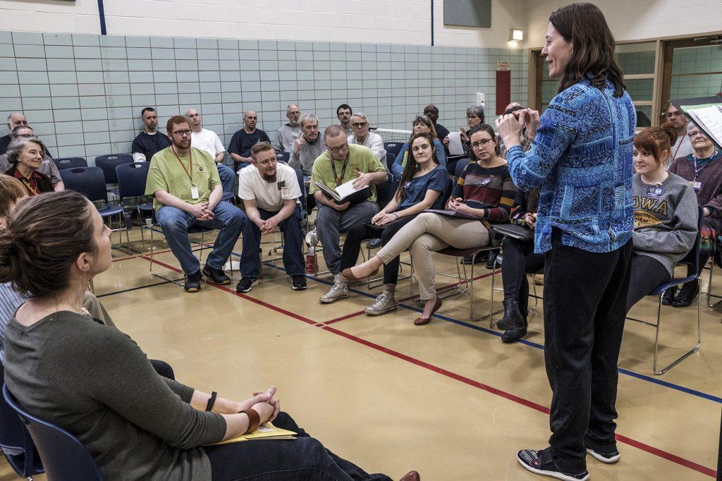 Director Mary Cohen instructs the Oakdale Community Choir at the Iowa Medical and Classification Center on March, 20, 2018. The choir consists of both inmates and outside volunteers. (Nick Rohlman/The Daily Iowan)