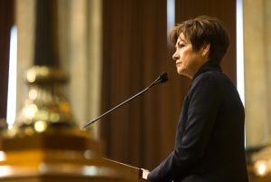 Iowa Gov. Kim Reynolds speaks during her first Condition of the State address in the Iowa State Capitol in Des Moines on January 9, 2018.