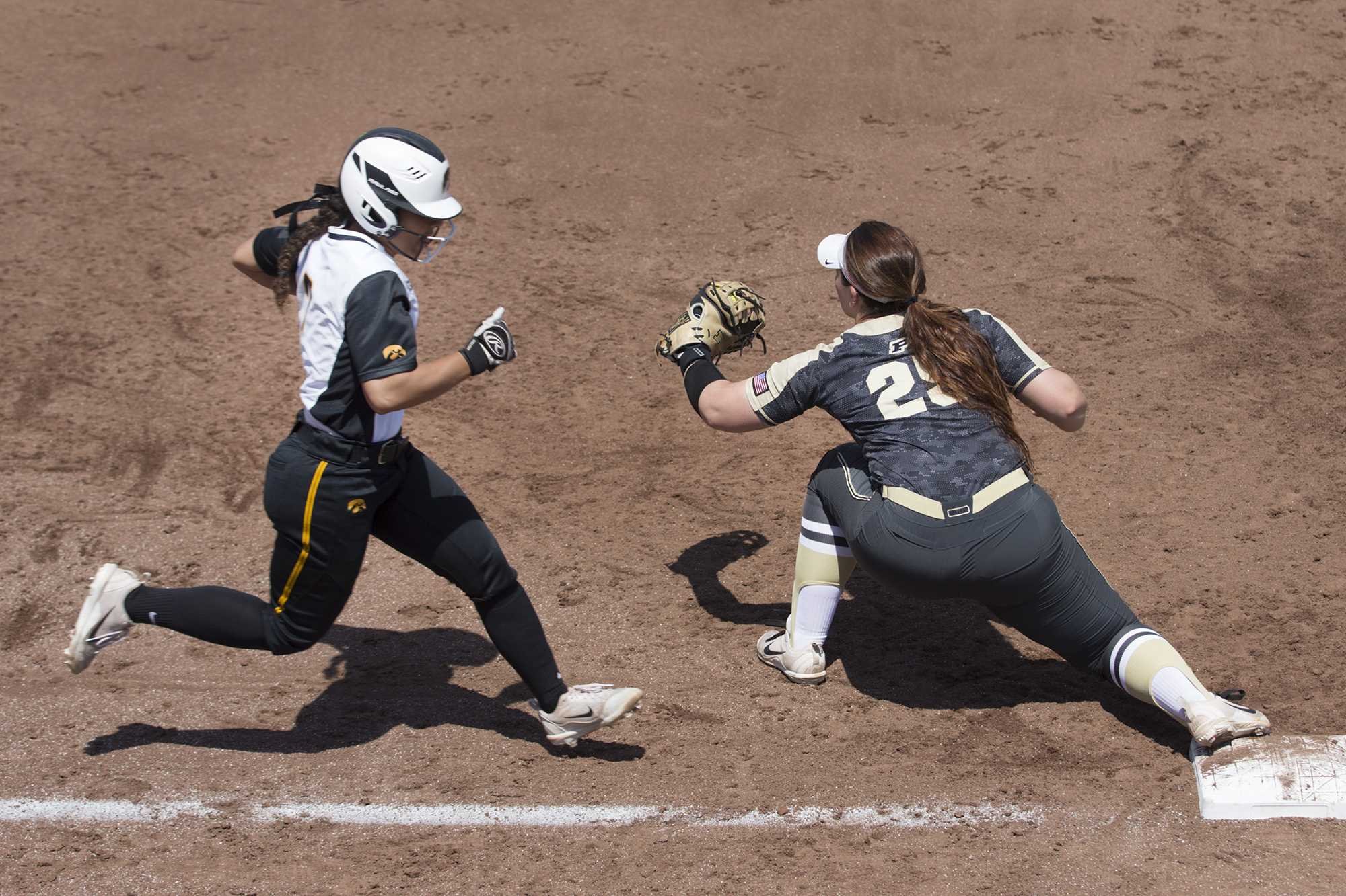 Iowa's Lea Thompson is tagged out by Purdue's Lexi Huffman during a softball game between Iowa and Purdue on Sunday, May 6, 2018. The Boilermakers spoiled the Hawkeyes' senior day, 6-0. (Shivansh Ahuja/The Daily Iowan)
