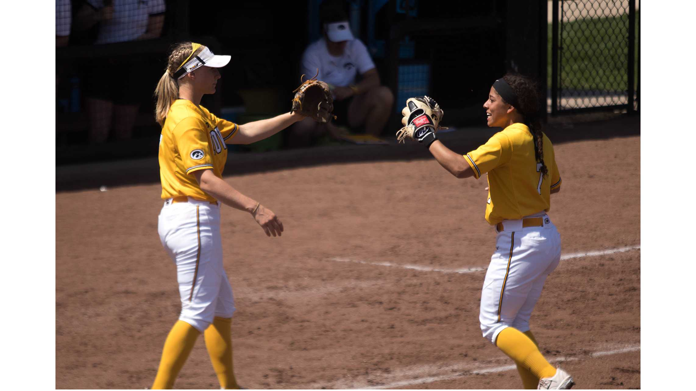 Lea Thompson high fives teammate during Iowa's game against Purdue at Pearl Field on May 5, 2018. The Hawkeyes were defeated 9-0. (Megan Nagorzanski/The Daily Iowan)