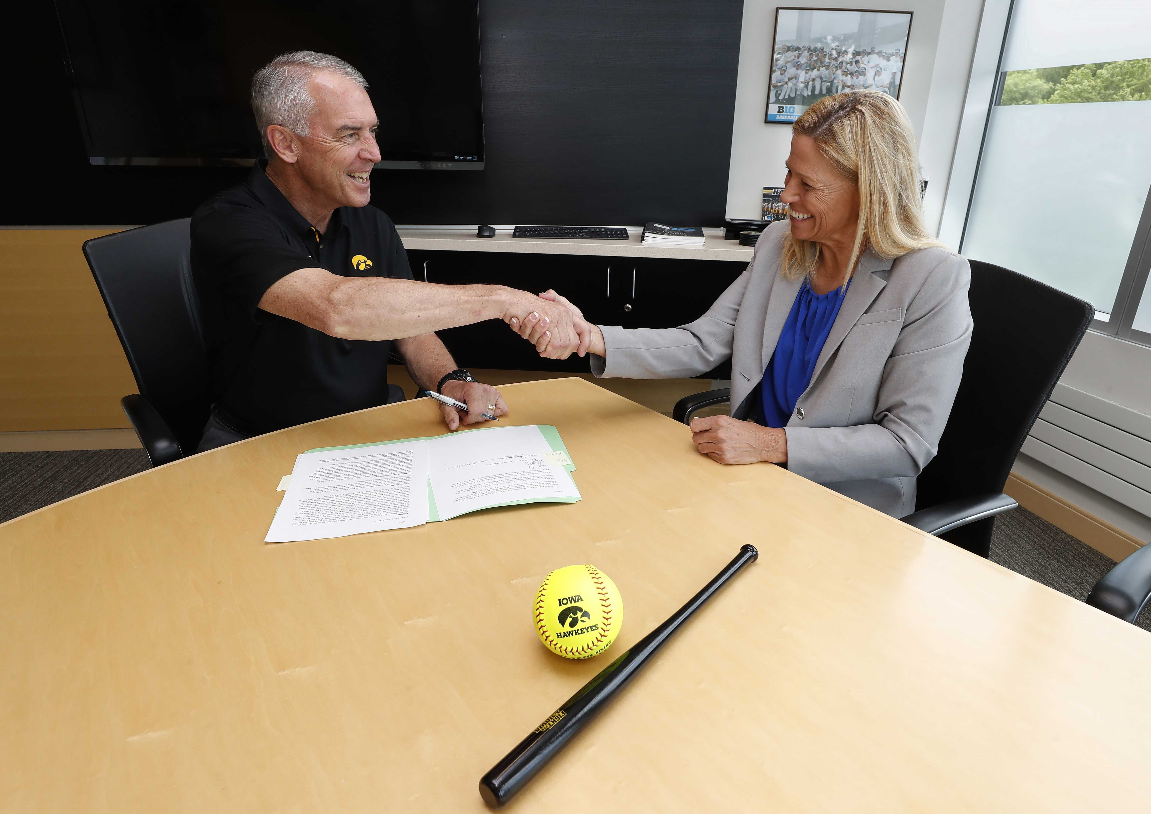 New University of Iowa Softball head coach Renee Gillispie shakes hands with Henry B. and Patricia B. Tippie Director of Athletics Chair Gary Barta after accepting the position Friday, June 8, 2018 at Carver-Hawkeye Arena.