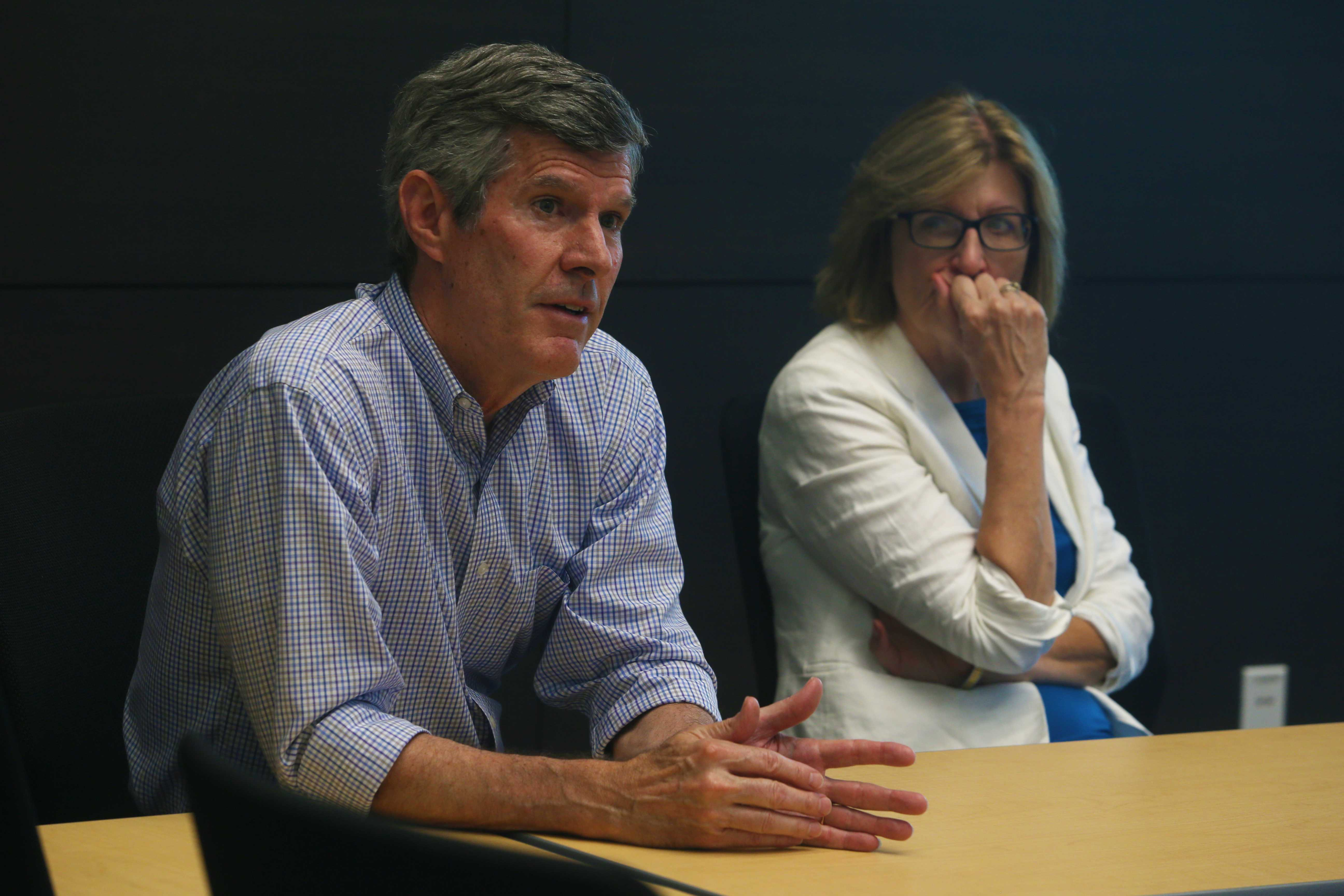 Democratic gubernatorial candidate Fred Hubbell and Lt. Gov. nominee state Sen. Rita Hart, D- Wheatland, listen to a presentation given at the Kirkwood Regional Center on June 18. (Tate Hildyard/The Daily Iowan)