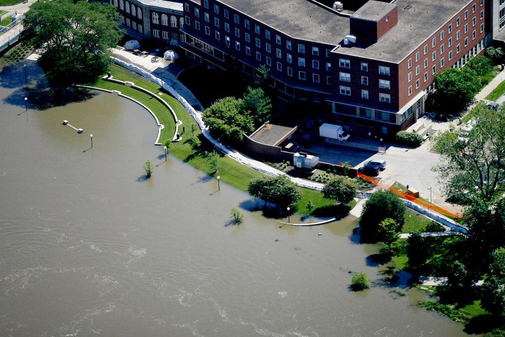 A sandbag wall protects the IMU as floodwaters move over the bank and onto the river terrace on June 10, 2008. (File photo/The Daily Iowan)