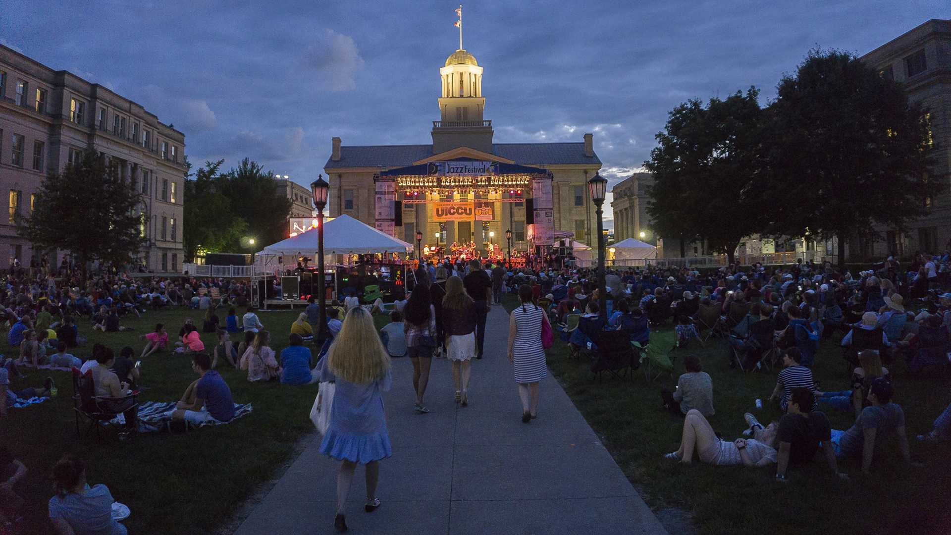 Spectators head to their seats for the headlining act during the night concert at the 2017 Jazz Fest on June 30th 2017. (File Photo/The Daily Iowan)