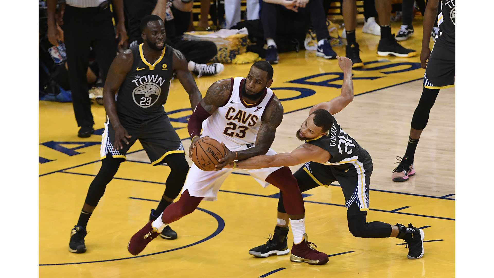 Draymond Green (23) and Stephen Curry (30) guard LeBron James (23) during the fourth quarter of Game 2 of the NBA Finals on Sunday, June 3, 2018 at Oracle Arena, in Oakland, Calif. The Golden State Warriors defeated the Cleveland Cavaliers, 122-103. (Jose Carlos Fajardo/Bay Area News Group/TNS)