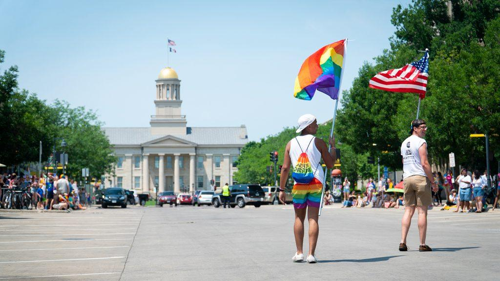 Participants+of+the+pride+parade+walk+towards+the+old+capital.+%28Roman+Slabach%2FThe+Daily+Iowan%29