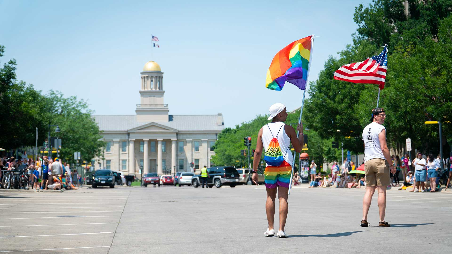 Participants of the pride parade walk towards the old capital. (Roman Slabach/The Daily Iowan)