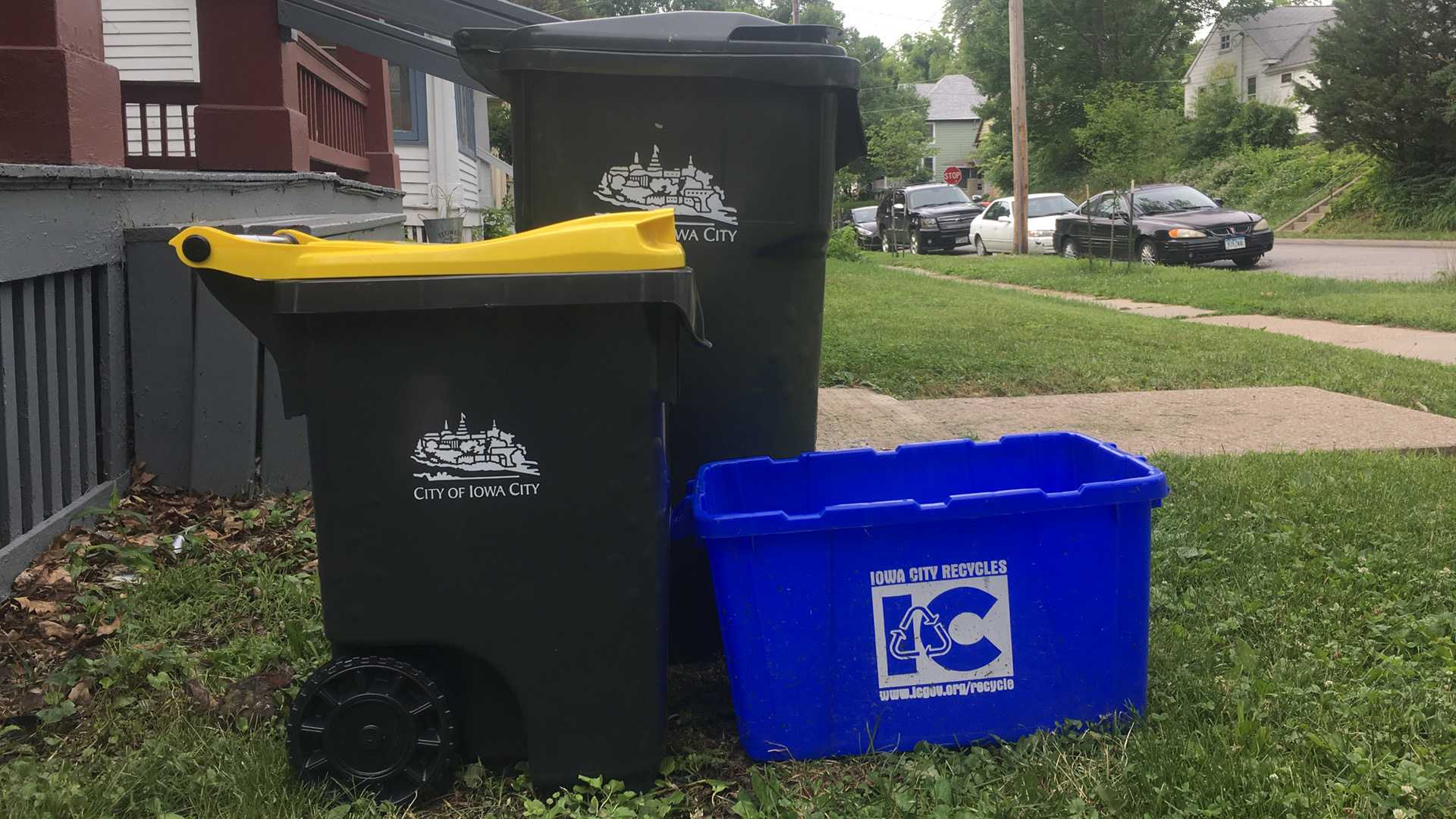 A 25-gallon composting cart stands beside a garbage can and a recycling bin. Iowa City is giving out 25- and 95-gallon composting carts to curbside customers. (Photo Illustration by Katelyn Weisbrod)