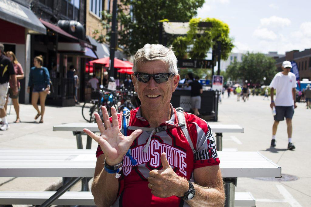 Lewis, 69, of Charleston, SC, celebrates finishing his sixth day of his first RAGBRAI in Iowa City on July 27, 2018.  An Ohio State graduate, he describes his experience in Hawkeye Nation as fabulous. Riders rode from Sigourney to Iowa City on Day 6 of this years event. (Michael Aragon/The Daily Iowan)