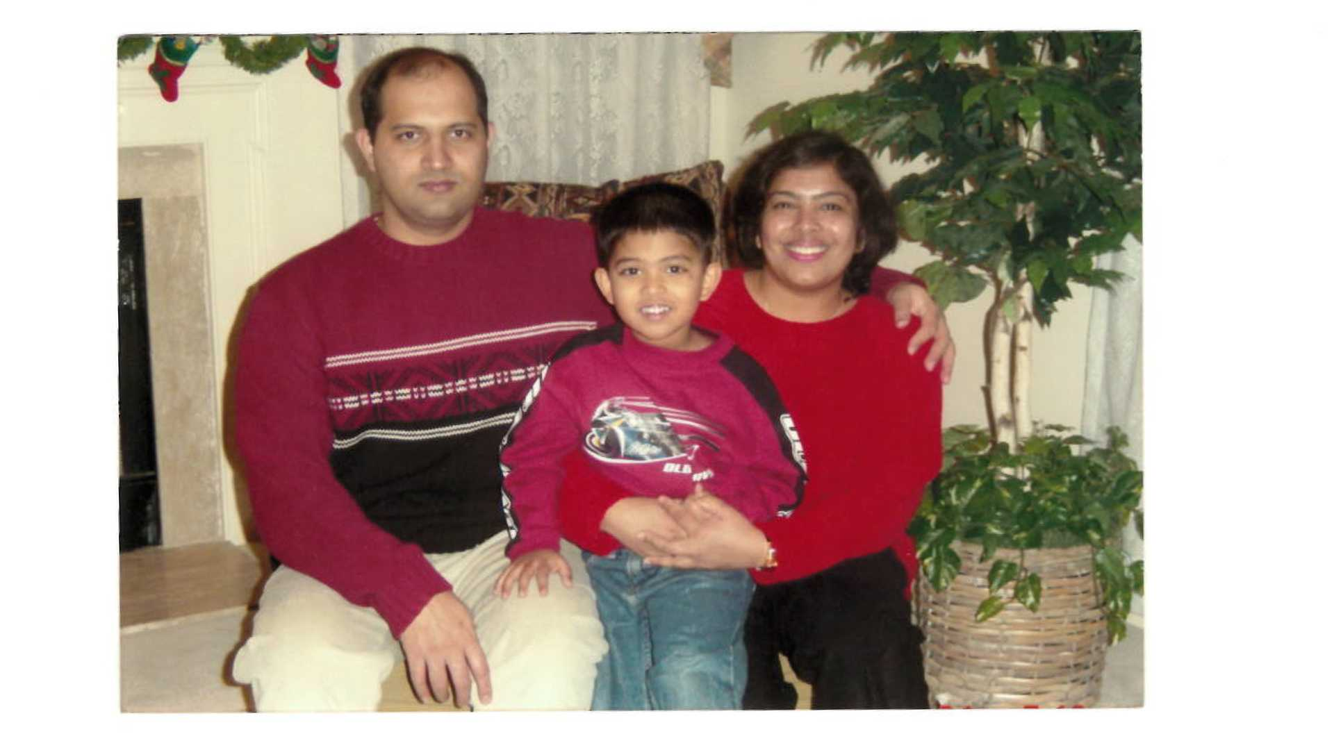 Aadit Tambe and his parents pose for a family photo in 2002. (Contributed)