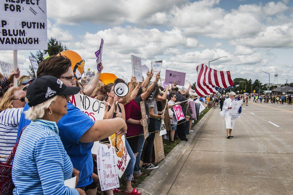Attendees await the arrival of President Donald Trump outside of Northeast Iowa Community College in Peosta on July 26, 2018. Both pro- and anti-Trump demonstrators were present for the event. (Katina Zentz/The Daily Iowan)