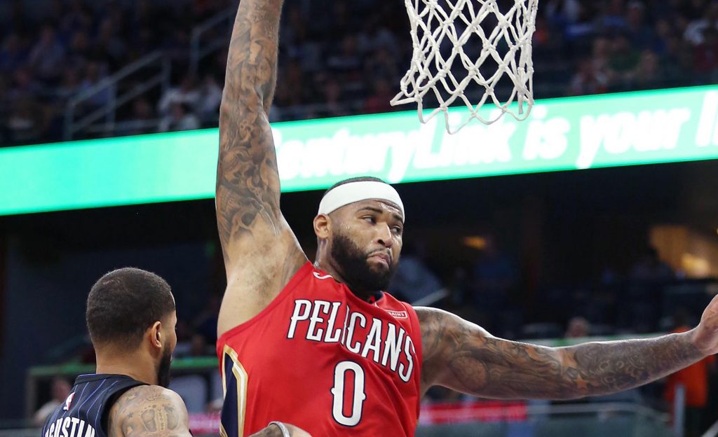 The+New+Orleans+Pelicans%26apos%3B+DeMarcus+Cousins+%280%29+leaps+over+the+Orlando+Magic%26apos%3Bs+D.J.+Augustin+%2814%29+and+Bismack+Biyombo+%2811%29+at+the+Amway+Center+in+Orlando%2C+Fla.%2C+on+December+22%2C+2017.+%28Stephen+M.+Dowell%2FOrlando+Sentinel%2FTNS%29