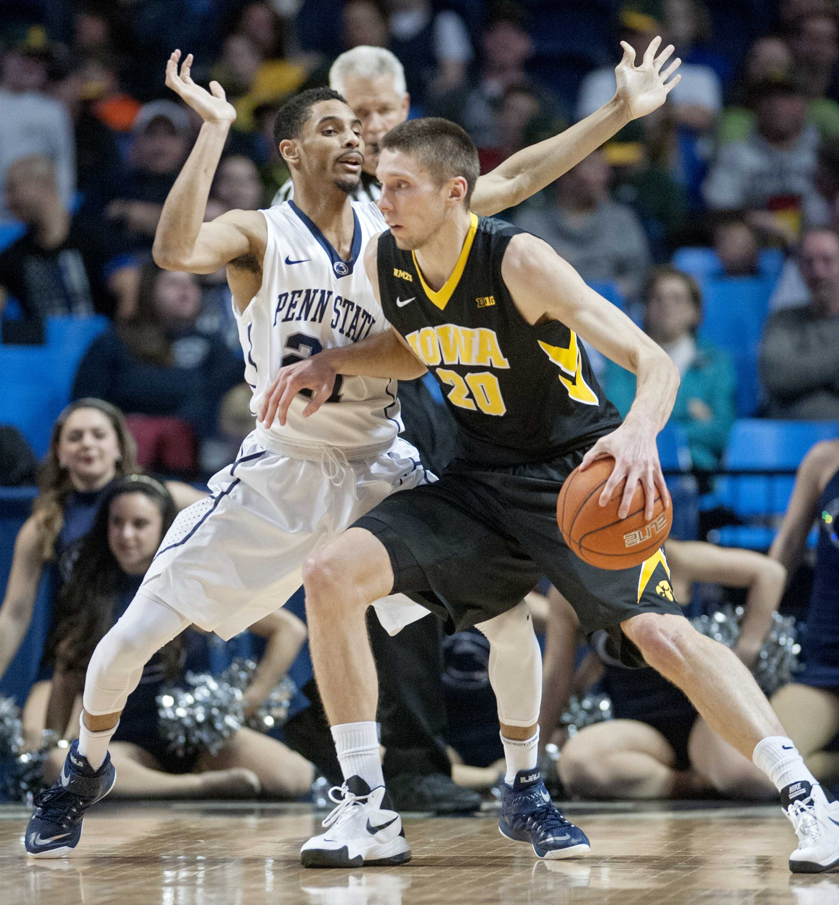 Iowa's Jarrod Uthoff, right, works off the dribble against Penn State's Isaiah Washington on Wednesday, Feb. 17, 2016, at the Bryce Jordan Center in University Park, Pa. The Nittany Lions upset Iowa, 79-75. (Abby Drey/Centre Daily Times/TNS)