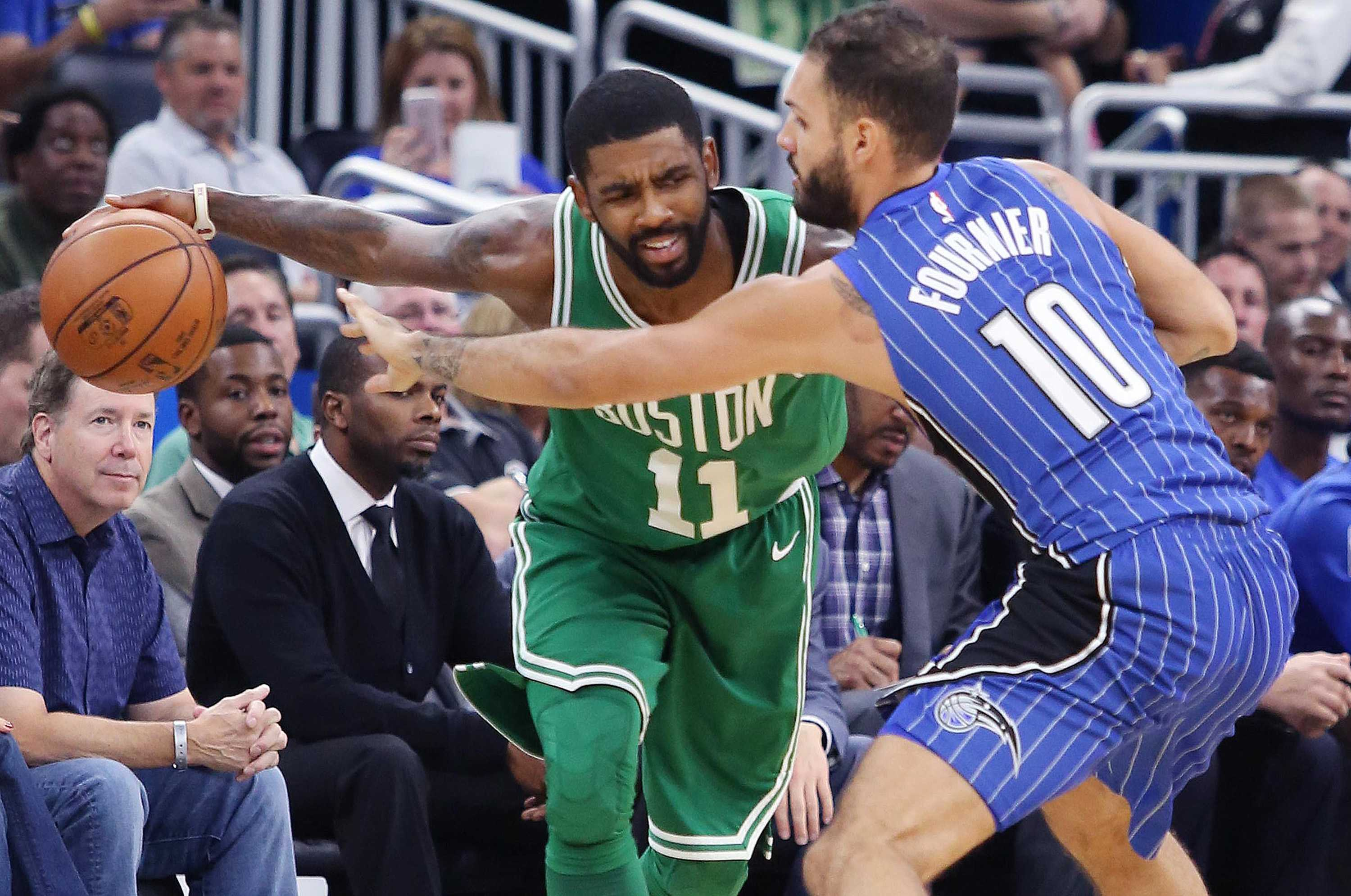 Orlando Magic forward Evan Fournier (10) tries to stop Boston Celtics guard Kyrie Irving (11) on Sunday, Nov. 5, 2017 at the Amway Center in Orlando, Fla. (Stephen M. Dowell/Orlando Sentinel/TNS)