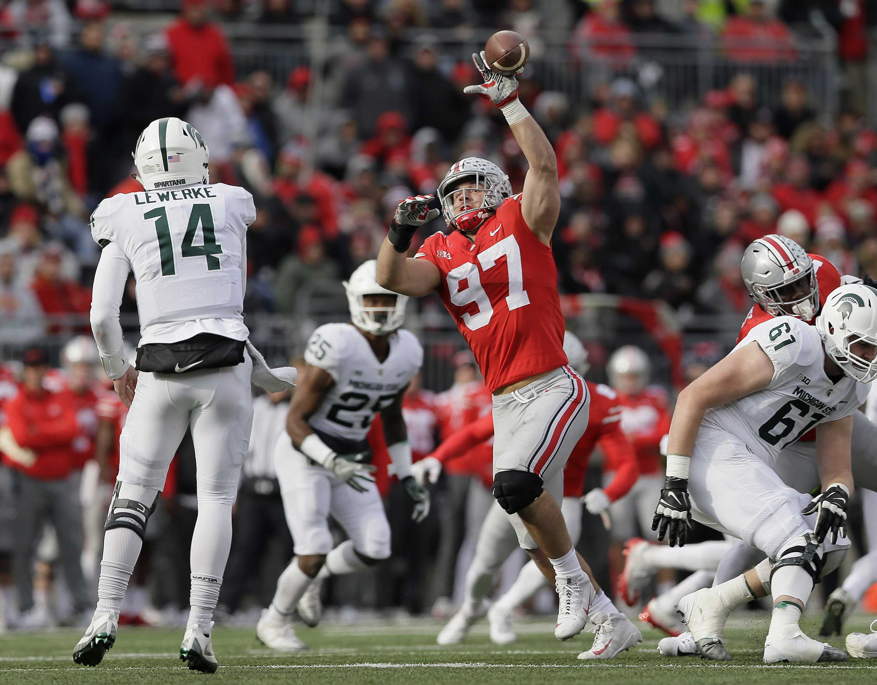 Ohio State Buckeyes defensive lineman Nick Bosa (97) bats down a pass by Michigan State Spartans quarterback Brian Lewerke (14) during the third quarter on Saturday, Nov. 11, 2017 at Ohio Stadium in Columbus, Ohio. (Adam Cairns/Columbus Dispatch/TNS)