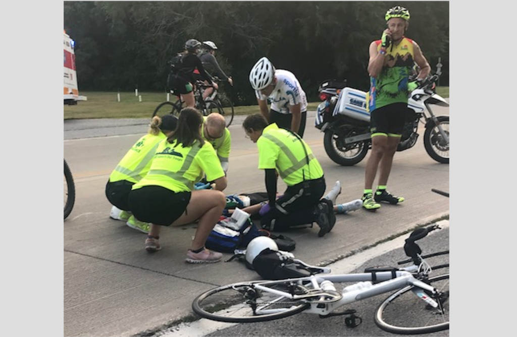 UIHC physicians and Care Ambulance Service paramedics assist an injured rider during RAGBRAI 2018. (Contributed)