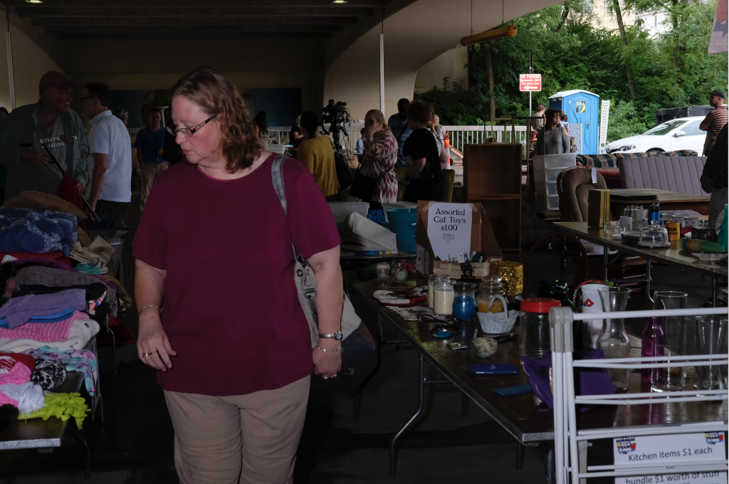 Shoppers peruse used kitchenware, clothing, and furniture during the Rummage in the Ramp pop up thrift store at the Chauncey Swan parking ramp on Wednesday July 26, 2017. Rummage in the Ramp is an event put on annually by the city of Iowa City in order to reduce the amount of belongings abandoned on curbs and to raise money for a variety of charitable organizations. (Nick Rohlman/The Daily Iowan)