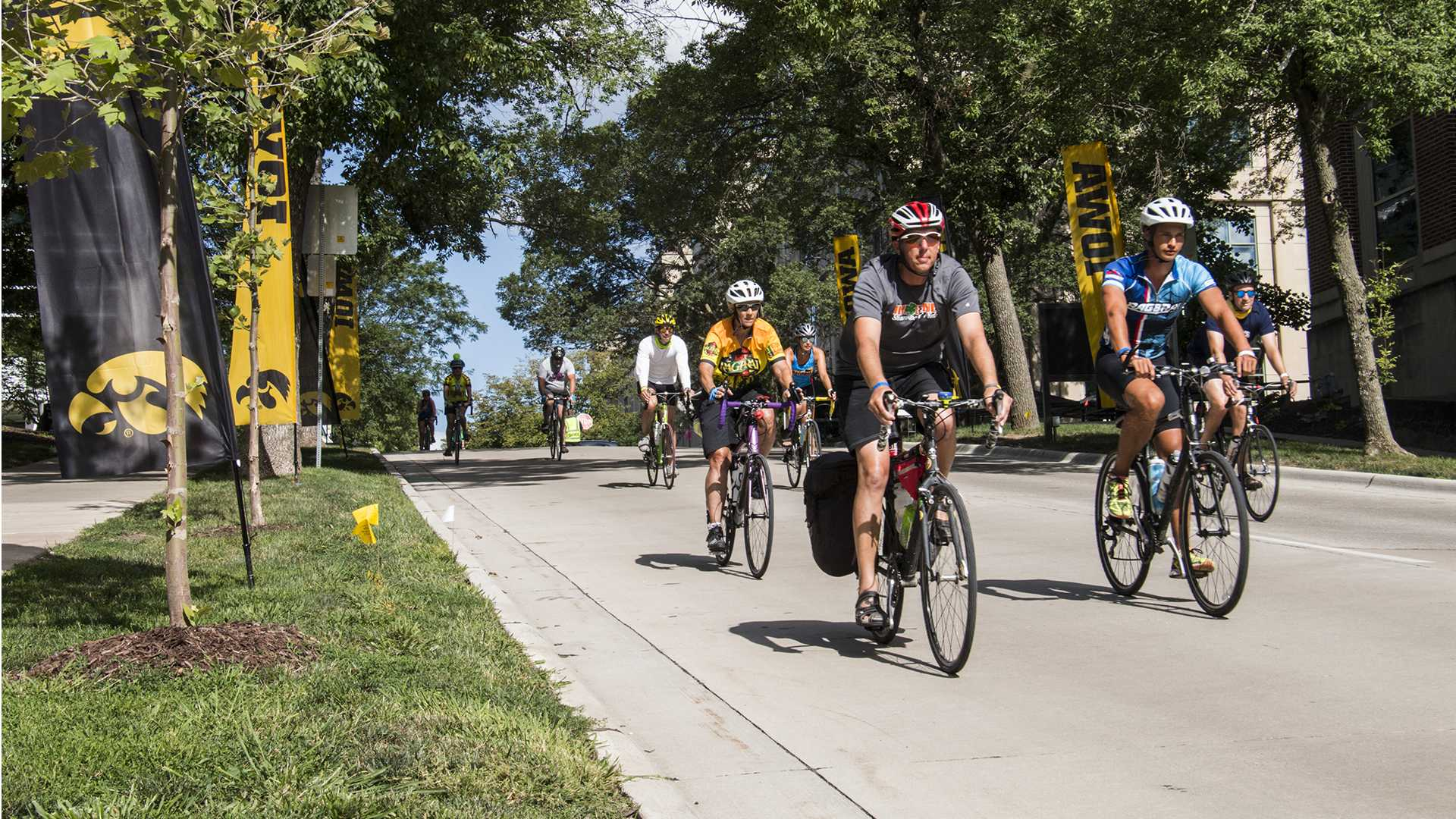 Bikers ride down the street during RAGBRAI on July 27, 2018. Riders rode from Sigourney to Iowa City on Day 6 of this year's event. (Katina Zentz/The Daily Iowan)