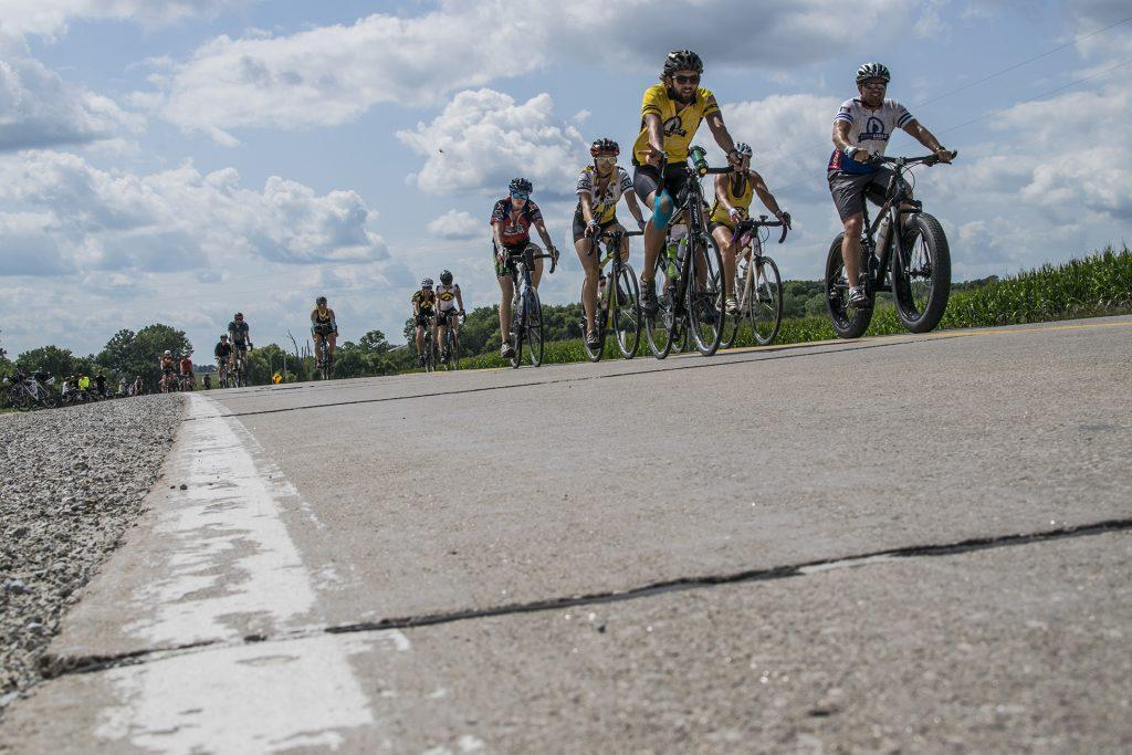 RAGBRAI riders cruise down the highway on Friday, July 22, 2018. This day totaled 57.6 miles for the riders. (Thomas A. Stewart/The Daily Iowan)