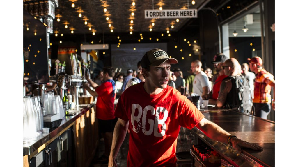 A bartender rushes to fill orders for beer at Big Grove Brewery during RAGBRAI on July 27, 2018. Riders rode from Sigourney to Iowa City on Day 6 of this year's event. (Katina Zentz/The Daily Iowan)