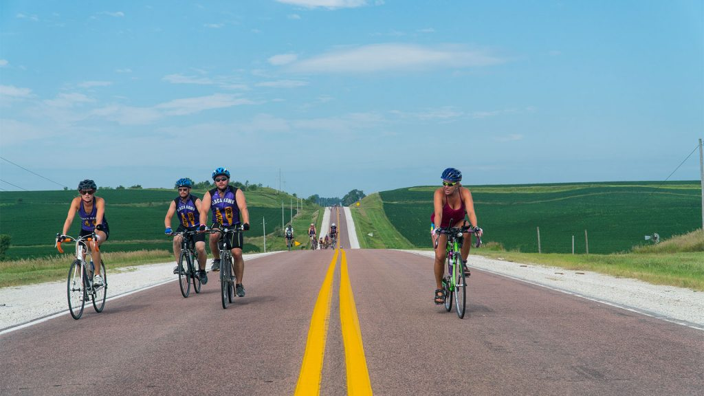 Bikers just outside of Aspinwall, Iowa ride through the nearby farmland on July 23. (Roman Slabach/The Daily Iowan)