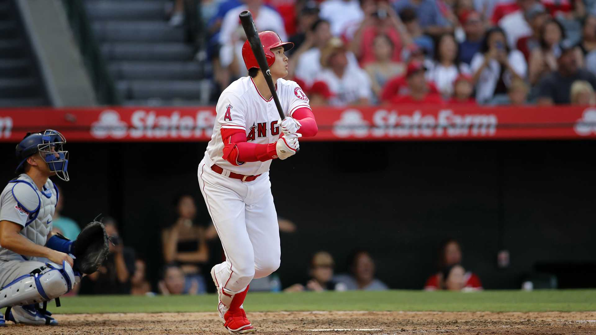 Angels slugger/pitcher Shohei Ohtani hits a home run to bring the Angels ahead of the Dodgers in the seventh inning at Angel Stadium Sunday, July 8, 2018 in Anaheim, Calif. The Dodgers won, 4-3. (Allen J. Schaben/Los Angeles Times/TNS)