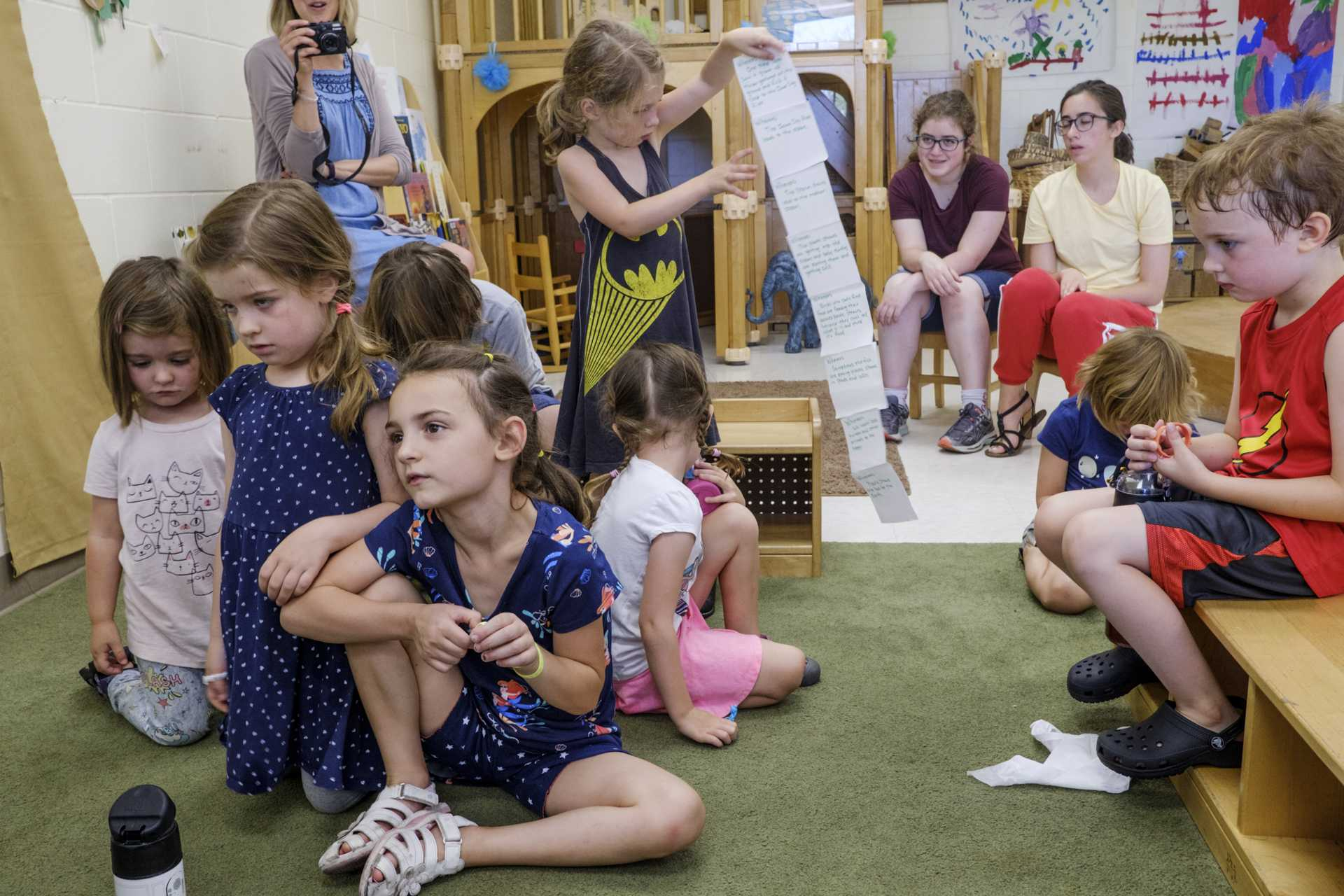 Tricia Windschitl's class at Preucil Preschool sits during a group interview on Thursday, July 5, 2018. The class wrote a proclamation to the Iowa City City Council calling for restaurants and individuals to reduce plastic straw use. (Nick Rohlman/The Daily Iowan)