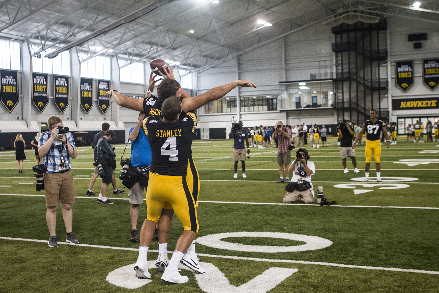 Iowa tight end T.J. Hockenson (left) and quarterback Nate Stanley (right) catch a football in the University of Iowa Indoor Practice Facility during Iowa Football Media Day on Friday, August 10, 2018. Iowa will open the 2018 football season at home against Northern Illinois on Saturday, September 1.