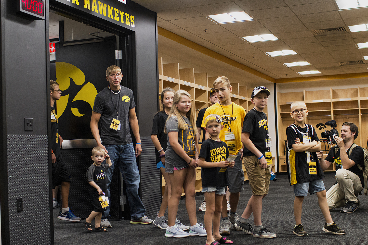 Kid+Captains+enter+the+football+locker+room+during+Iowa+Football+Kids%27+Day+at+Kinnick+Stadium+on+Saturday%2C+Aug.+11%2C+2018.+The+2018+Kid+Captains+met+the+Iowa+football+team+and+participated+in+a+behind-the-scenes+tour+of+Kinnick+Stadium.