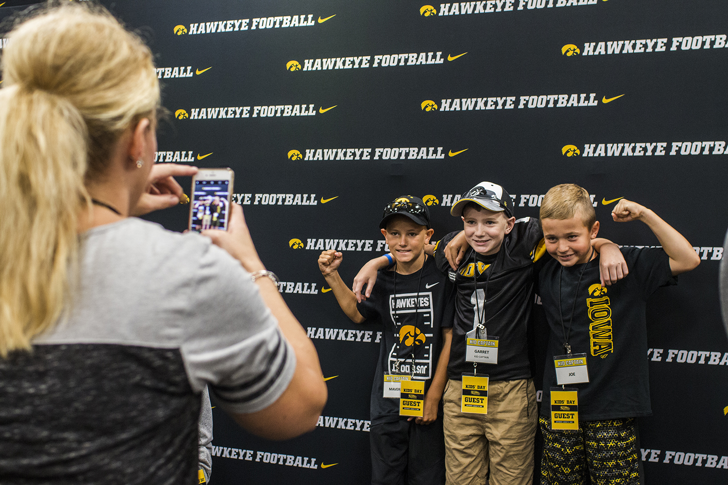 Kid+Captain+Garret+Schuster+has+a+picture+taken+with+his+family+during+Iowa+Football+Kids%27+Day+at+Kinnick+Stadium+on+Saturday%2C+Aug.+11%2C+2018.+