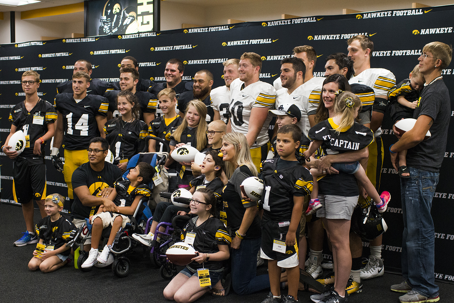 The+Iowa+football+team+takes+a+photo+with+the+Kid+Captains+and+their+families+during+Iowa+Football+Kids%27+Day+at+Kinnick+Stadium+on+Saturday%2C+Aug.+11%2C+2018.+