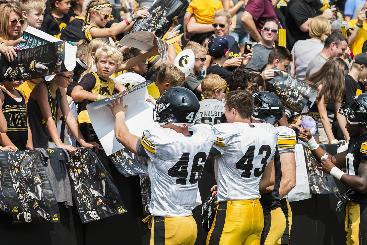 The+Iowa+football+team+signs+posters+during+Iowa+Football+Kids%27+Day+at+Kinnick+Stadium+on+Saturday%2C+Aug.+11%2C+2018.+