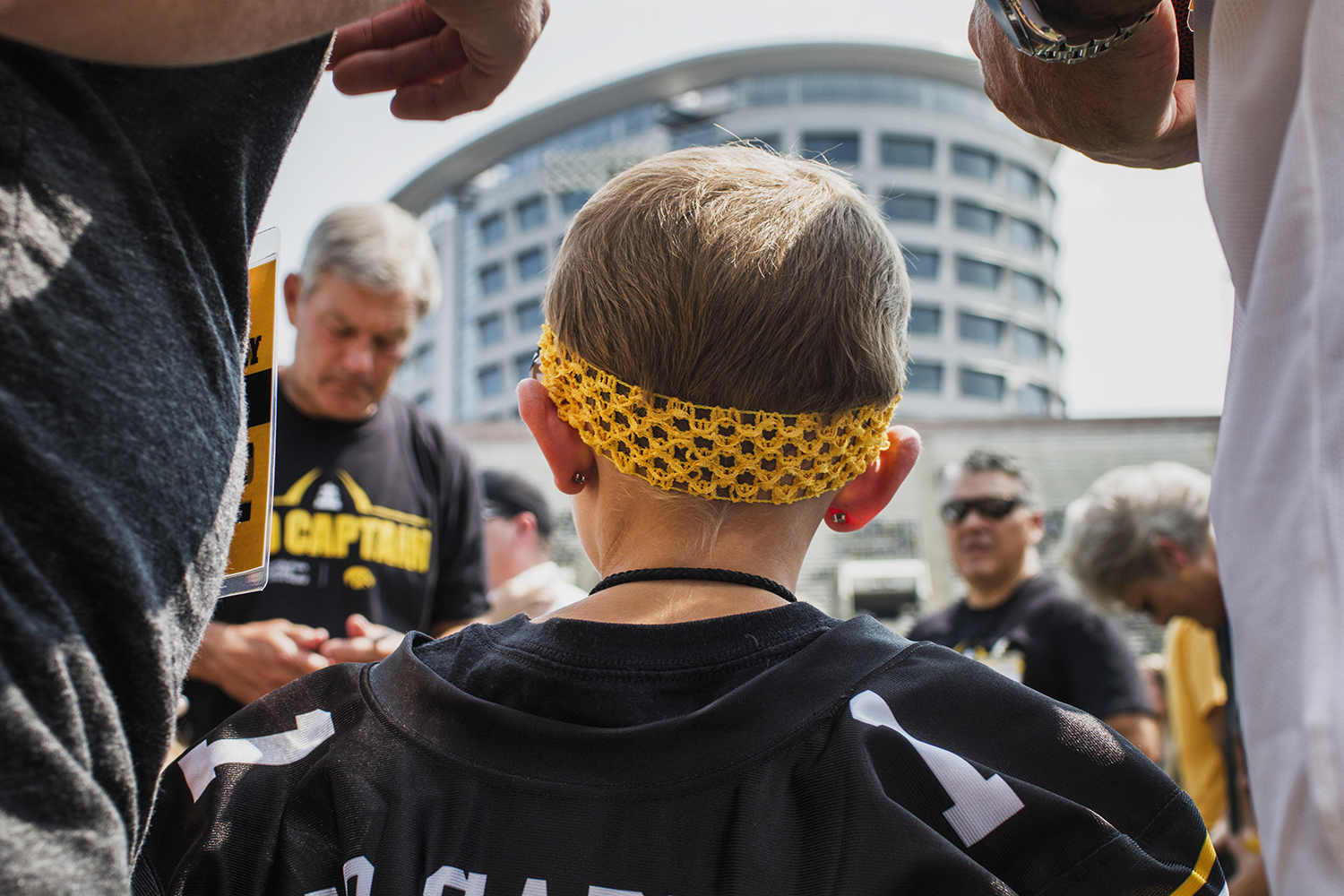 Kid Captain Harper Stribe waits to meet Iowa head coach Kirk Ferentz during Iowa Football Kids' Day at Kinnick Stadium on Saturday, Aug. 11, 2018. The 2018 Kid Captains met the Iowa football team and participated in a behind-the-scenes tour of Kinnick Stadium.