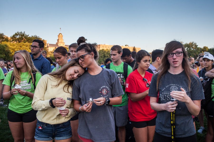 Community+members+gather+to+pay+their+respects+during+a+vigil+in+memory+of+UI+student+Mollie+Tibbetts+at+Hubbard+Park+on+Wednesday%2C+Aug.+22%2C+2018.+Tibbetts+went+missing+on+July+18%2C+in+Brooklyn%2C+Iowa.+