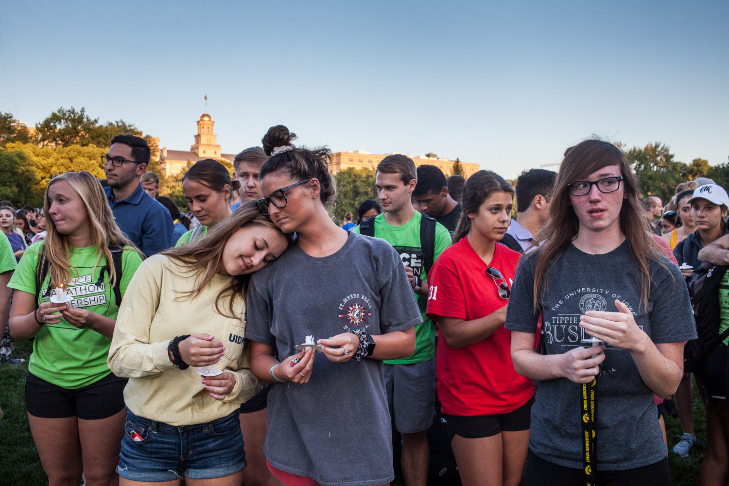 Community members gather to pay their respects during a vigil in memory of UI student Mollie Tibbetts at Hubbard Park on Wednesday, Aug. 22, 2018. Tibbetts went missing on July 18, in Brooklyn, Iowa.