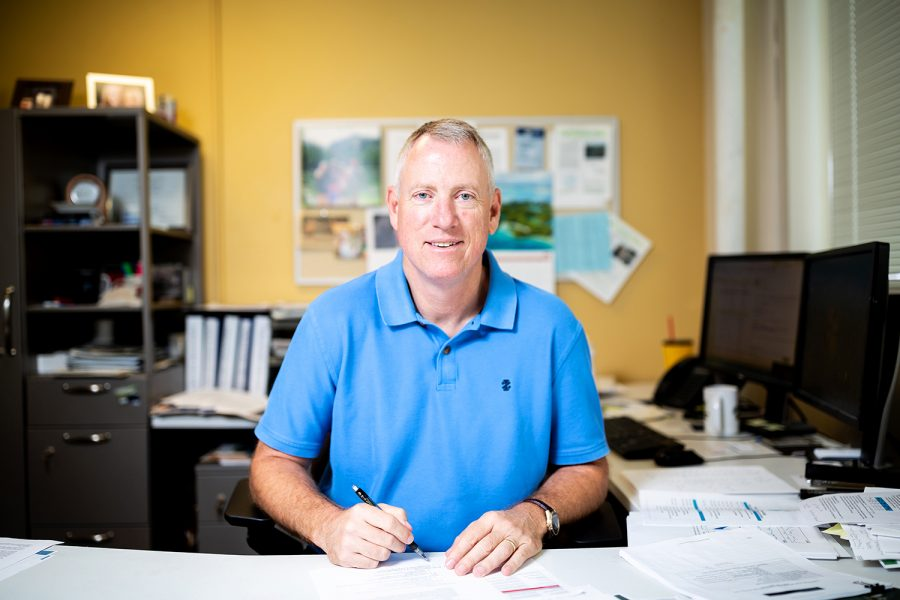 Keith Schilling, newly appointed state geologist within the Iowa Geological Survey, sits in his office in Trowbridge Hall on Monday, Aug. 14, 2018.