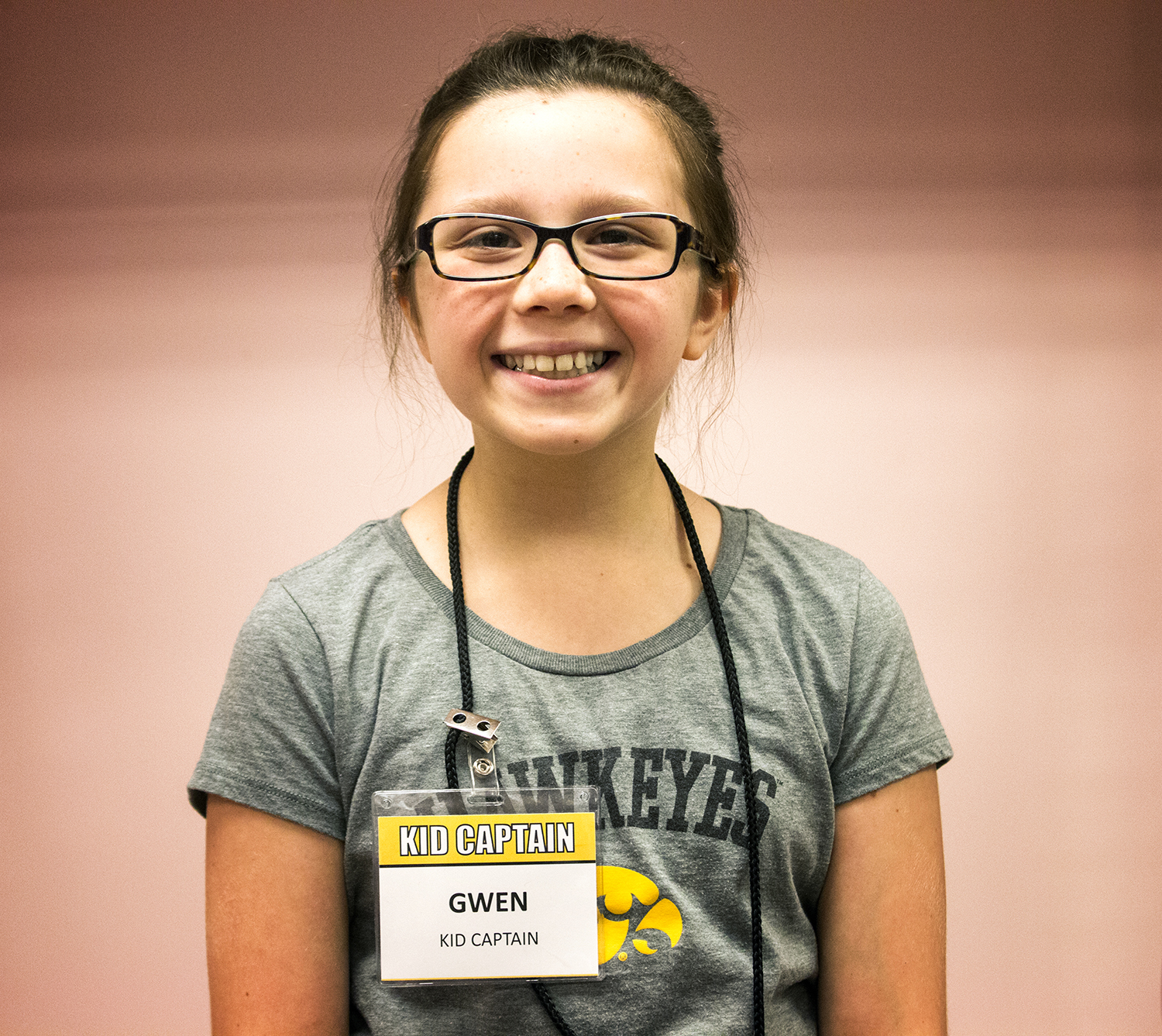 Kid Captain Gwen White smiles for a portrait during Iowa Football Kid's Day at Kinnick Stadium on Saturday, Aug. 11, 2018. The 2018 Kid Captains met the Iowa football team and participated in a behind-the-scenes tour of Kinnick Stadium. Gwen's story will be featured during Iowa's first home game on Saturday.