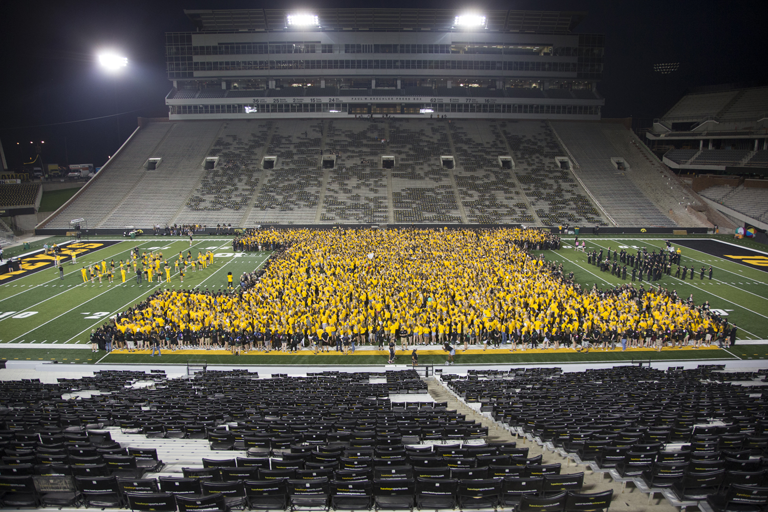 Freshmen form an I during Kickoff at Kinnick in Kinnick Stadium located in Iowa City on Aug. 17, 2018. During this On Iowa event, students were able to rush the field, listen to music, learn the fight song, and watch fireworks.