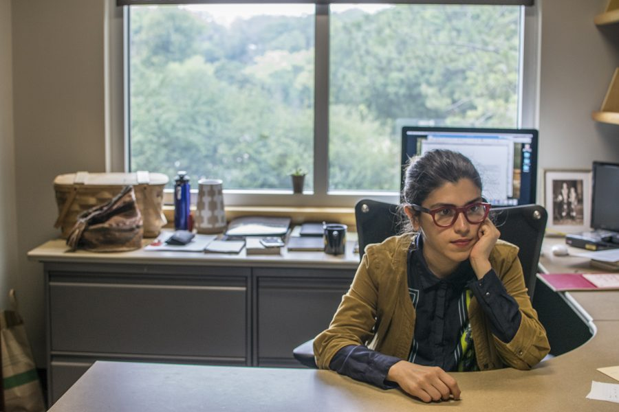 Anahita Ghazvinzadeh sits at her desk on Tuesday, August 21st, 2018. This is her first year teaching at the University of Iowa. (Thomas A. Stewart/The Daily Iowan)
