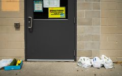 Donations sit outside the door to the Food Bank for the Crisis Center of Johnson Coutny on Sunday, Aug. 19, 2018. The Food Bank allows Johnson County residents to accept grocery assistance once per week.