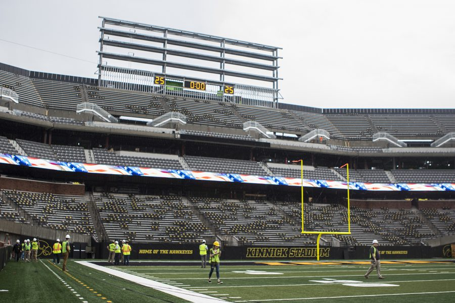 Members+of+the+media+tour+north+end+zone+construction+at+Kinnick+Stadium+on+Tuesday%2C+August+28%2C+2018.+Construction+is+set+to+be+completely+finished+by+the+2019+football+season%2C+with+outdoor+club+seating+ready+for+the+2018+season.+The+Hawkeyes+open+their+season+at+Kinnick+Stadium+on+Saturday%2C+September+1%2C+against+Northern+Illinois.+%28Lily+Smith%2FThe+Daily+Iowan%29