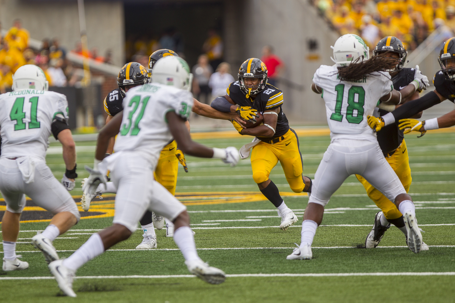 Iowa's Ivory Kelly-Martin takes the handoff during the game between Iowa and North Texas at Kinnick Stadium on Saturday Sept. 16, 2017. Iowa won 31-14. (Nick Rohlman/The Daily Iowan)