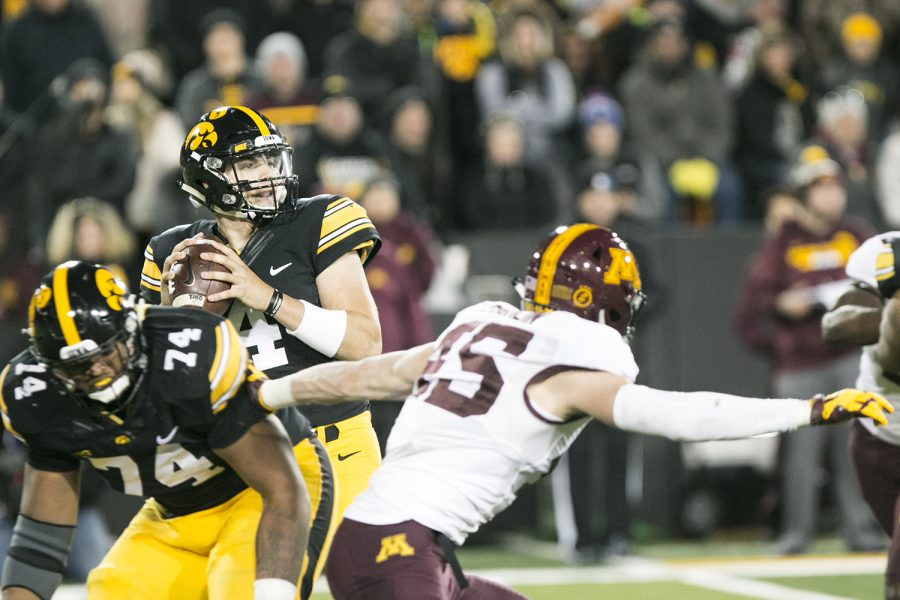 Iowa quarterback Nate Stanley looks to throw during an Iowa/Minnesota football game in Kinnick Stadium on Saturday, Oct. 28, 2017. The Hawkeyes defeated the Golden Gophers, 17-10.
