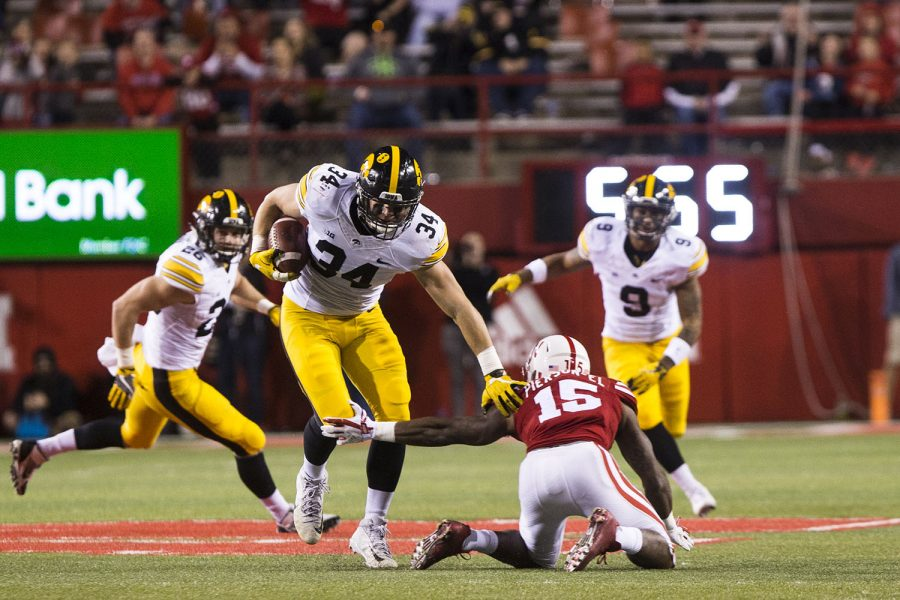 Iowa+linebacker+Kristian+Welch+avoids+Nebraska+wide+receiver+De%27Mornay+Pierson-El+after+intercepting+a+deflected+pass+during+the+Iowa%2FNebraska+football+game+in+Memorial+Stadium+on+Friday%2C+Nov.+24%2C+2017.+The+Hawkeyes+defeated+the+Cornhuskers%2C+56-14.+