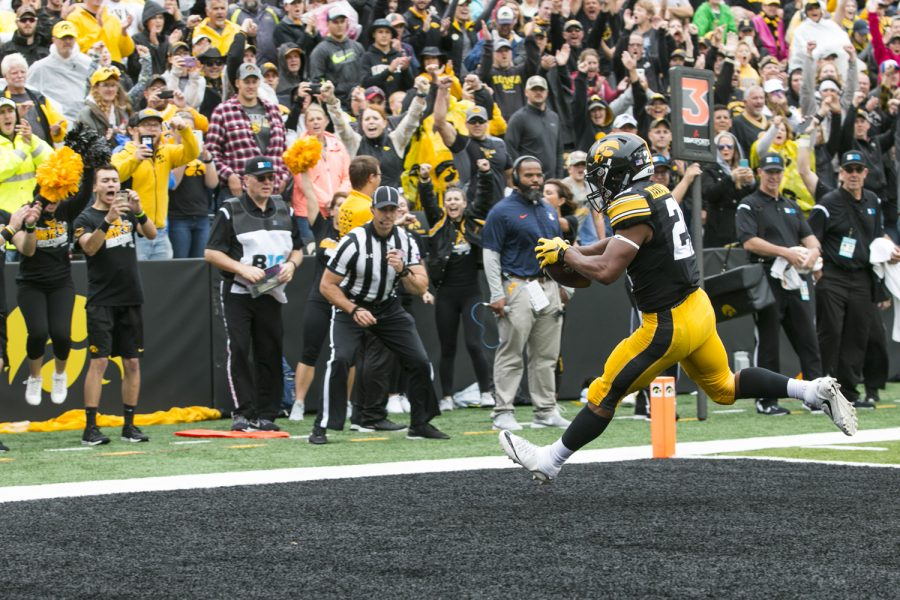 Iowa running back Ivory Kelly-Martin catches a touchdown pass during an NCAA football game between Iowa and Illinois in Kinnick Stadium on Saturday, Oct. 7, 2017.  The Hawkeyes defeated the Fighting Illini, 45-16.