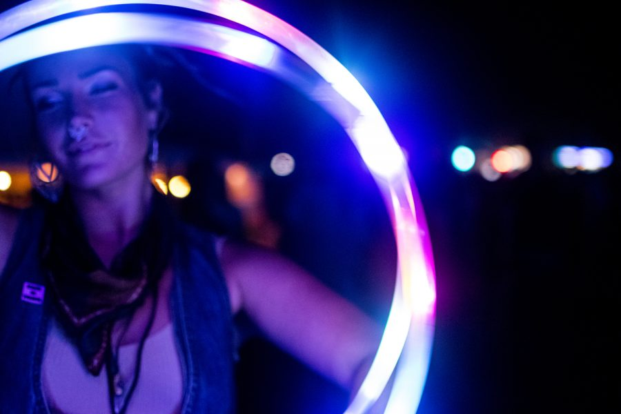 Audra+Lewis+dances+with+a+glowing+hula+hoop+on+Friday+Aug.+3%2C+2018.+She+lives+in+Minnesota+but+has+attended+the+festival+every+year.+This+is+Hinterland%27s+fourth+year.+%28Thomas+A.+Stewart%2FThe+Daily+Iowan%29