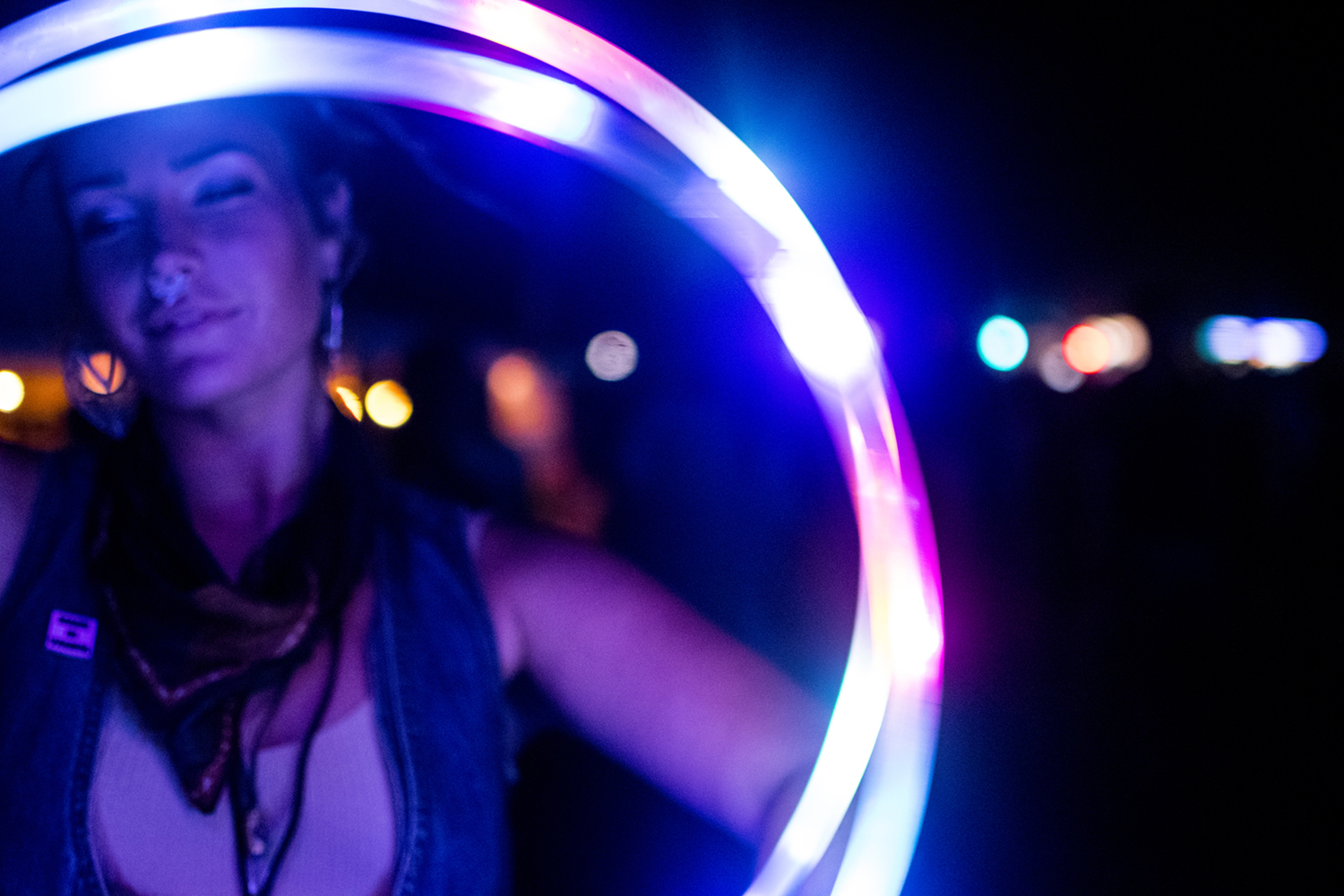 Audra Lewis dances with a glowing hula hoop on Friday Aug. 3, 2018. She lives in Minnesota but has attended the festival every year. This is Hinterland's fourth year. (Thomas A. Stewart/The Daily Iowan)