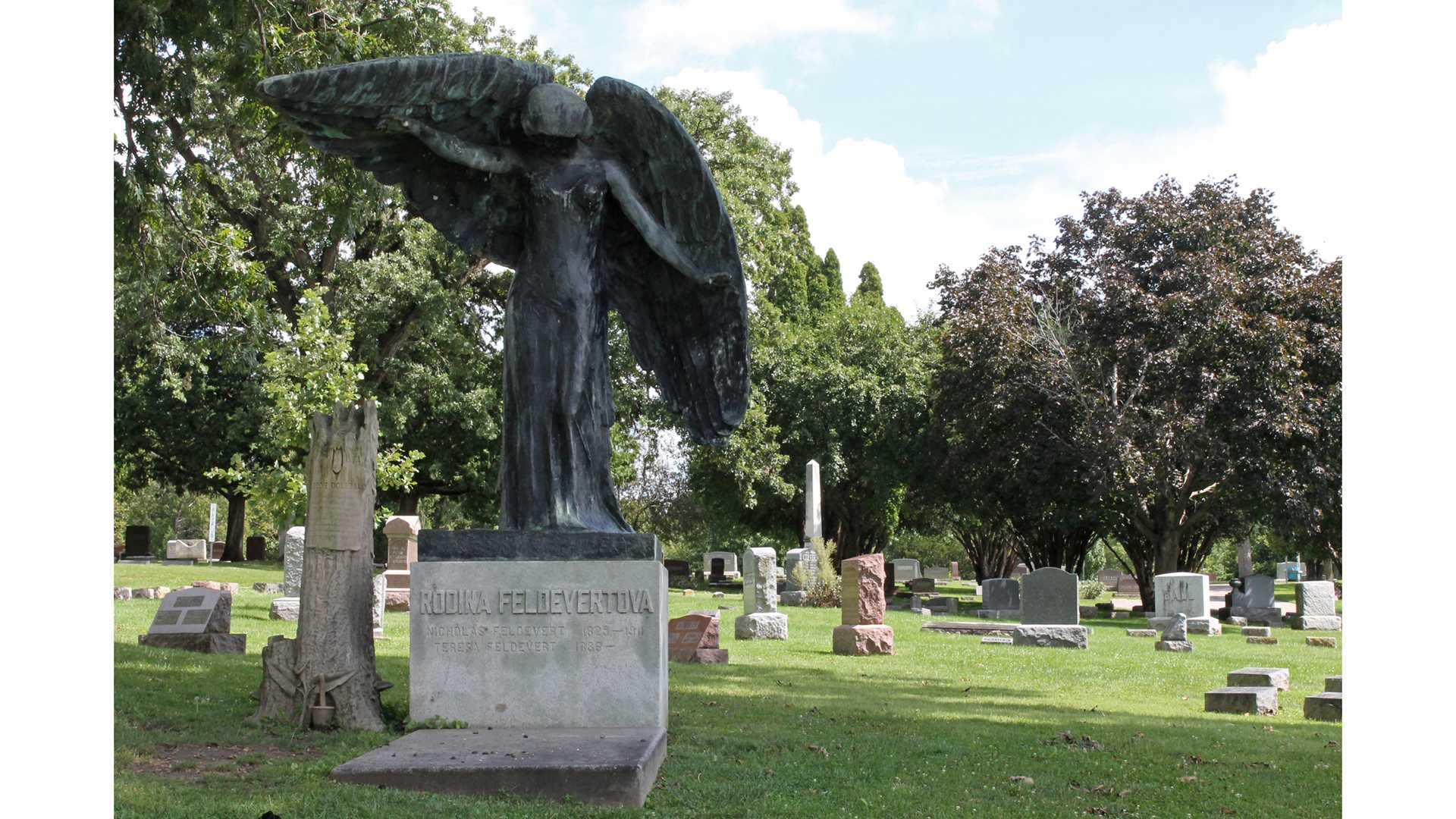 The black angel is photographed at Oakland Cemetery in Iowa City on Monday, September 7, 2015. The black angel is an eight and a half foot tall burial monument built for the Feldevert family in 1912. Since then, it has been the source of many legends in Iowa City; most of which are connected to the mysterious change in color that the angel took, turning from a golden bronze to black. (The Daily Iowan/McCall Radavich)