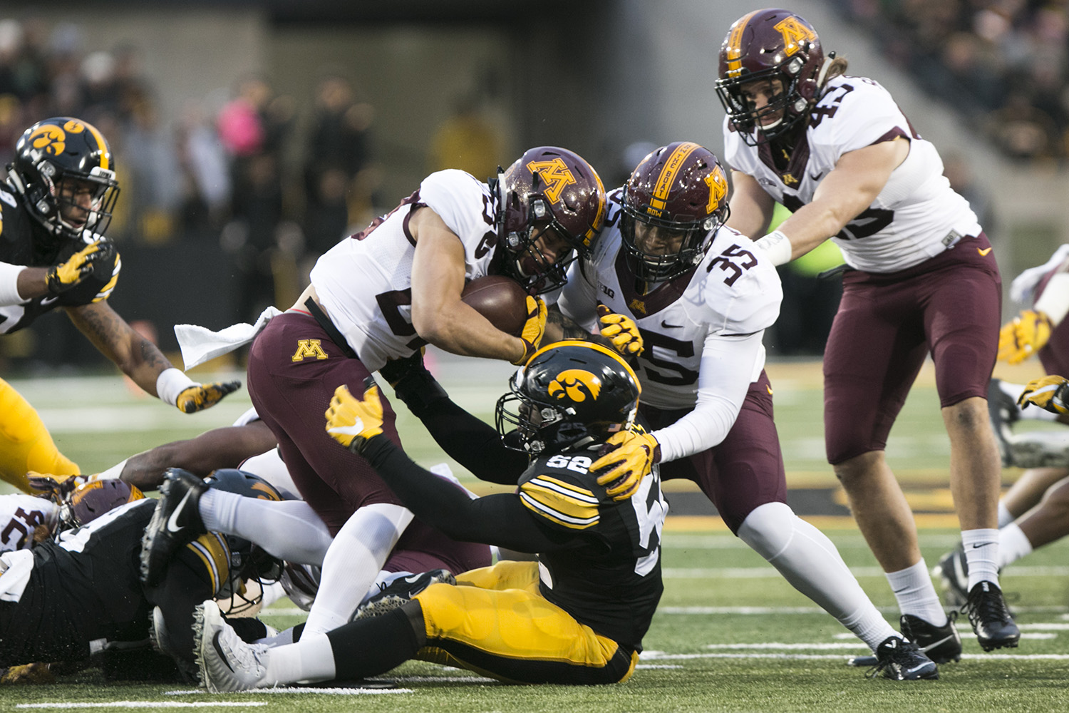 Minnesota running back Shannon Brooks gets tackled by Iowa linebacker Amani Jones during an Iowa/Minnesota football game in Kinnick Stadium on Oct. 28, 2017. The Hawkeyes defeated the Golden Gophers, 17-10.