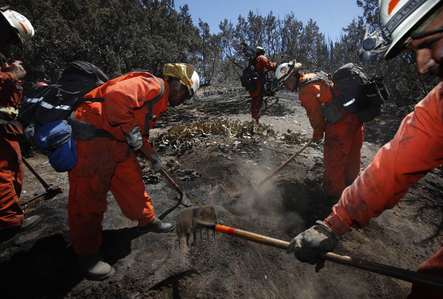 Inmate firefighters based in Acton, California, work to overhaul hot spots left from the Crown Fire in Palmdale, California, on Saturday, July 31, 2010.  The Crown Fire has burned more than 14,000 acres.